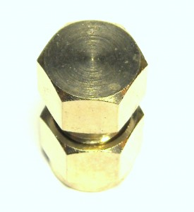 Photo of a dual ferrule compression end cap from Outdoor Cooling Systems.