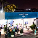An evening view of the Bombay Sapphire Lounge where our misting system was installed.