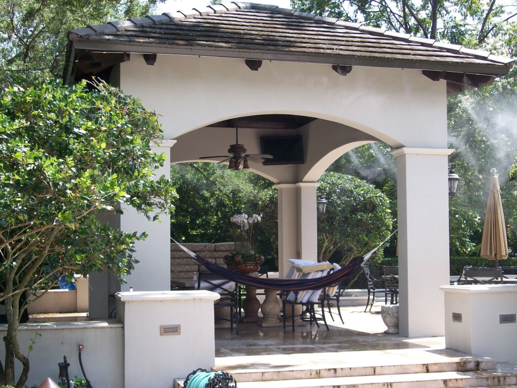 This misting system in Coral Gables was installed around the perimeter of the gazebo. Two misting fans are hidden behind the columns. The misting pump is installed remotely on a pool equipment  slab.