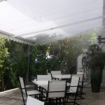 Misting Direct brand equipment was used to create this misting system installed on a retractable awning.